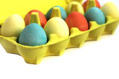 Easter eggs in box Stock Photos