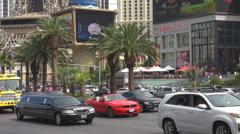 Traffic street congestion Las Vegas Nevada Stip pedestrian walking car pass USA Stock Footage