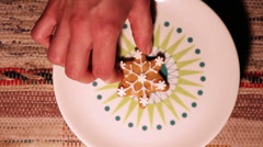 Laying gingerbread on a plate. Stock Footage