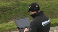 Stock Video Footage of Coach checking data on laptop