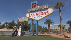 Las Vegas welcome sign entrance strip marriage bride groom Elvis Presley show US Stock Footage