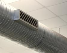 Tube for the air-conditioning of a large office Stock Photos