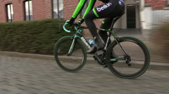 Professional cyclist on cobblestones road Stock Footage