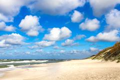 Sand beach on baltic sea Stock Photos