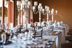 Decorated tables with candelabra at wedding reception, selective Stock Photos