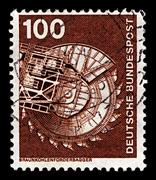 Germany-circa 1975:a stamp printed in germany shows image of machinery for br Stock Photos