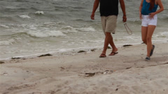Father and daughter walking on the beach-low angle Stock Footage