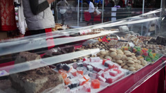 Selling Turkish delight, cookies and candies at local market Stock Footage