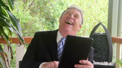 Laughing Businessman Sitting Stock Footage