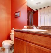 red bathroom corner with a washbasin cabinet - stock photo