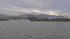View of yacht and boats docked at the pier of cairns Stock Footage