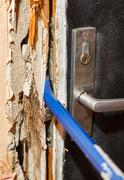 Hack the door with a crowbar - stock photo