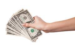 Female hand holding money dollars isolated on white background - stock photo