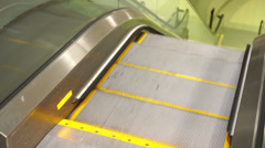 Moving escalator with warning light. Stock Footage