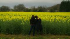 Lesbian partners admire Rapeseed field ZOOM Stock Footage