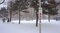 Private Property No Trespassing sign on snowy property in blizzard. Stock Footage
