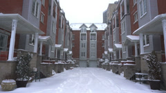 Snowy alley between townhouses in the city. Stock Footage