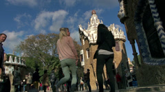 Stock Video Footage of Tourists in Parc Guell square and Barcelona