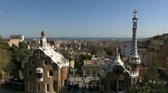 Stock Video Footage of Tourists in Parc Guell square and Barcelona skyline from rooftop