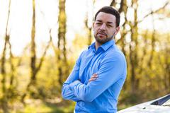 outdoor portrait of a young latin american man - stock photo
