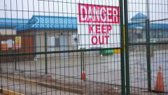 Pan right on construction site to Danger! Keep out sign Stock Footage