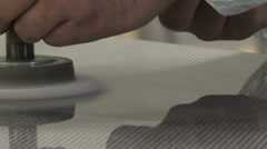 Worker sanding carbon fibre component - stock footage