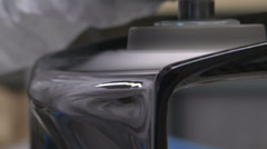 Worker polishing carbon fibre - stock footage