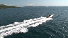 Aerial view of navigating maxi rib Stock Footage