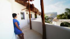 Latin-American model in hotel terrace Stock Footage