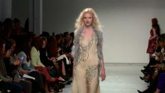 Tall blonde model walks down the runway. NYC Fashion Week. Stock Footage