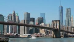 New York City manhattan skyline ove Brooklyn Bridge pan Stock Footage