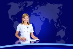 Smiling anchorwoman at tv studio Kuvituskuvat