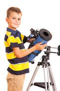 Child Looking Into Telescope on white - stock photo