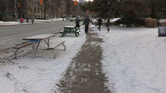College students jousting in a park in the snow in winter Stock Footage