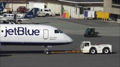 Airplane tow tug Stock Footage