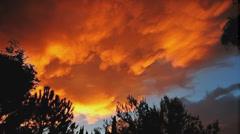 Composited sky on fire sunset timelapse under-lit clouds artwork - stock footage