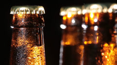 Cold Bottles of Beer on Black Background Stock Footage