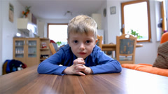 Cute Child On Living Room Table Smiling In Camera Stock Footage