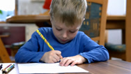 Stock Video Footage of Young kid Drawing On Paper In Slow Motion