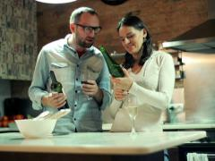 Young couple tasing wine in kitchen at home NTSC Stock Footage