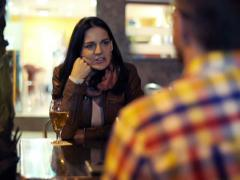 Young couple talking on date in outdoor bar at night NTSC Stock Footage