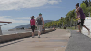 Stock Video Footage of cinematic dolly shot  people walking at cairns esplanade
