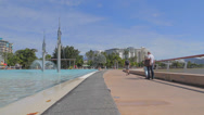 Stock Video Footage of cinematic dolly shot  people walking and in the pool at cairns esplanade