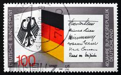 Stock Photo of Postage stamp Germany 1989 National Crest and Flag