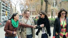 Young happy group of friends talking and walking in the city HD Stock Footage