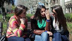 Girlfriends comforting their sad friend on bench in the city HD - stock footage