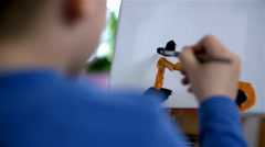 Little Guy Drawing With Watercolors on Canvas Stock Footage