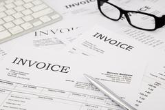 Invoices and bills on office table Stock Photos