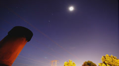 Very cool long-exposure timelapse night sky with chimney sparks - stock footage