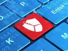 Safety concept: Broken Shield on computer keyboard background - stock illustration